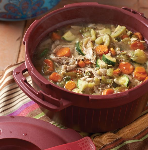 A whole chicken, onions, carrots, zucchini and more make this flavorful soup a hearty, protein-packed, one-pot meal.