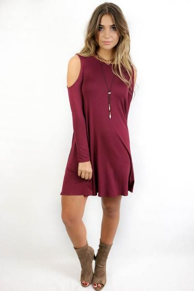 Burgundy long sleeve dress features cold shoulder details Material is Rayon and Spandex Not Lined Made in the USA Bust Length Small 15 33 Medium 16 34 Large 17