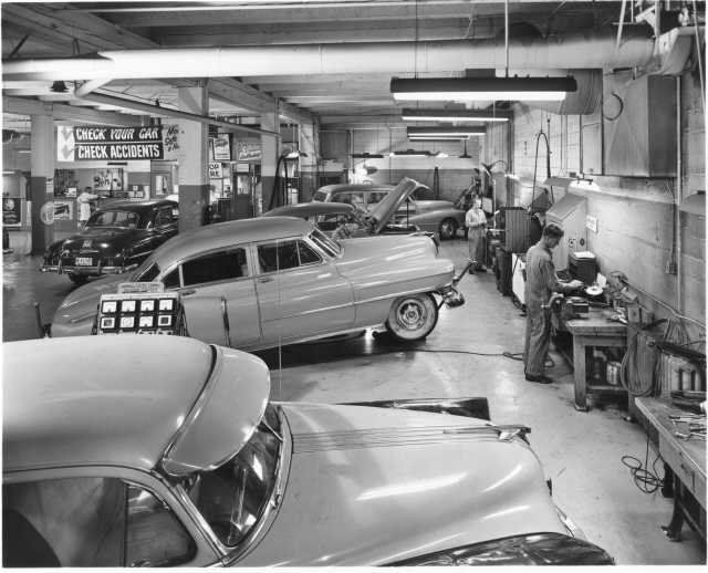 This vintage car dealership and auto shop can be compared to Mr. Wilson's car dealership.