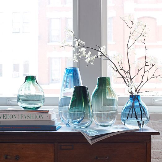 We worked with a Brooklyn-based glassblower to create these Tinted Glass Vases, which are delicately shaded with a subtle ombre effect. They offer a classic canvas for your blooms.