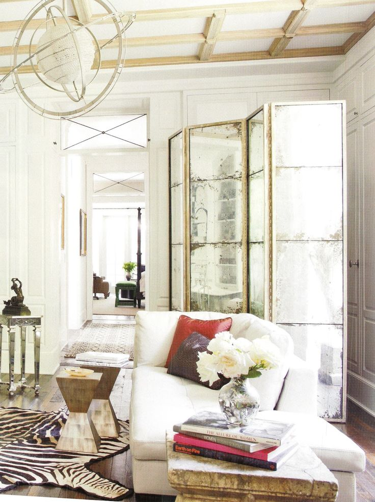Just WOW. Love the old mirrors, the architectural element of the glass above the doors. <3