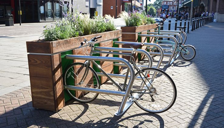 The Planter Rack - Cool Design & available in NZ!  Nice way to create some separation and also looks like it would size well to fit into 'reclaimed' kerb space (aka car park)