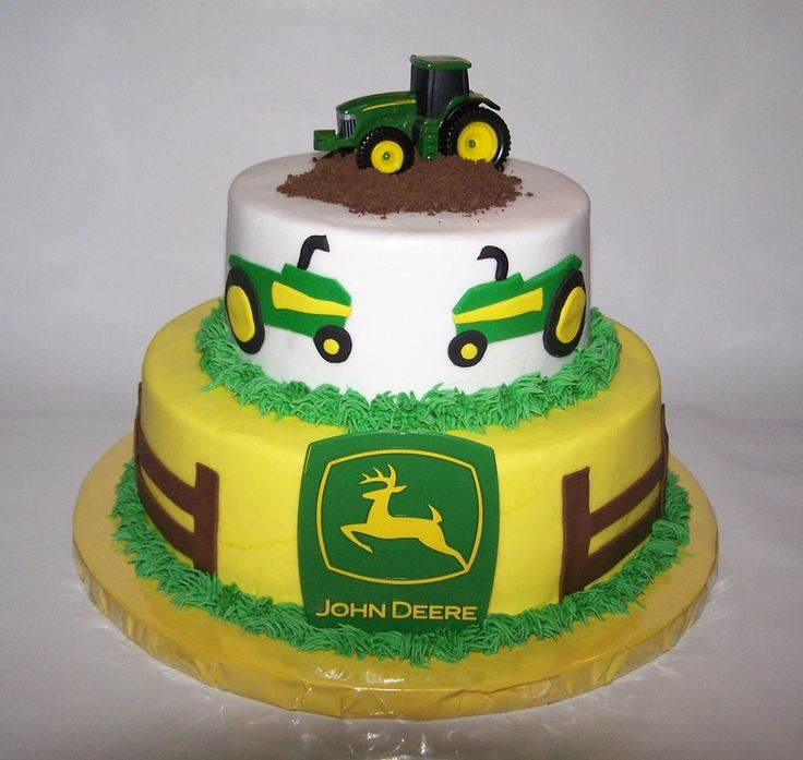9in 6in stacked John Deere Cake - iced in buttercream with fondant accents - the tractor and sign are not edible - thanks for all of the gre...