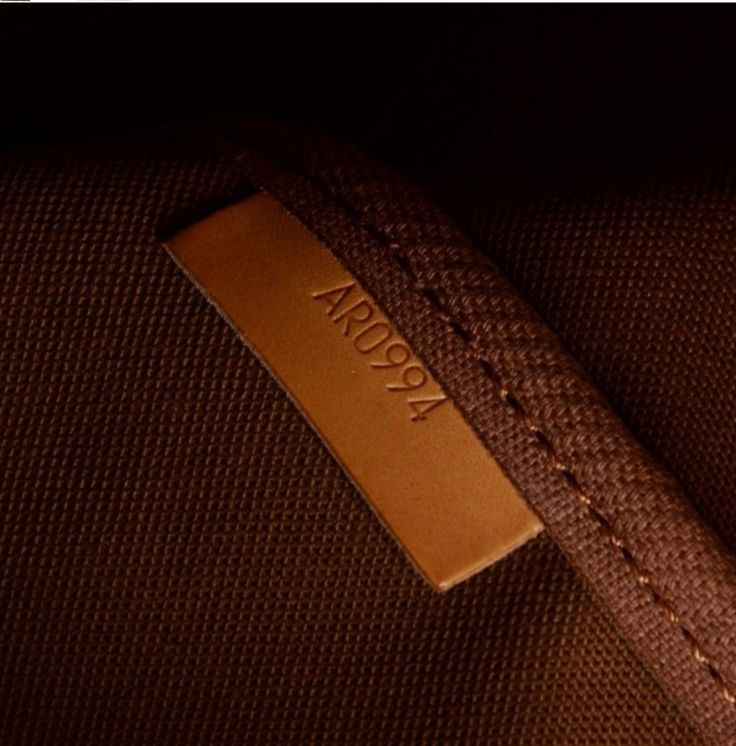 Date code in Louis Vuitton monogram Saumur 35.