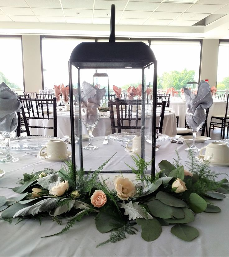 Soft, elegant, gorgeous centerpiece greenery for wedding decor.  majolica spray rose, seeded eucalyptus, silver dollar, fern, dusty miller, lanterns.