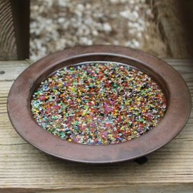 Take a mixture of seed beads and some epoxy and breathe new life into an old tray.