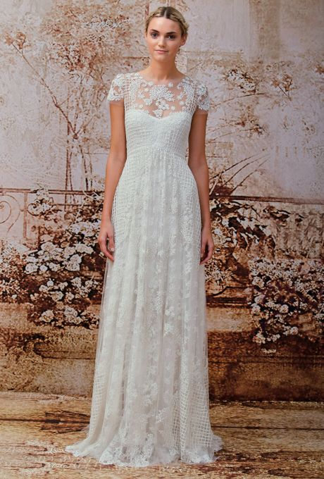 Brides.com: Monique Lhuillier - Fall 2014. Lace and net sheath wedding dress with high illusion neckline and short sleeves, Monique Lhuillier