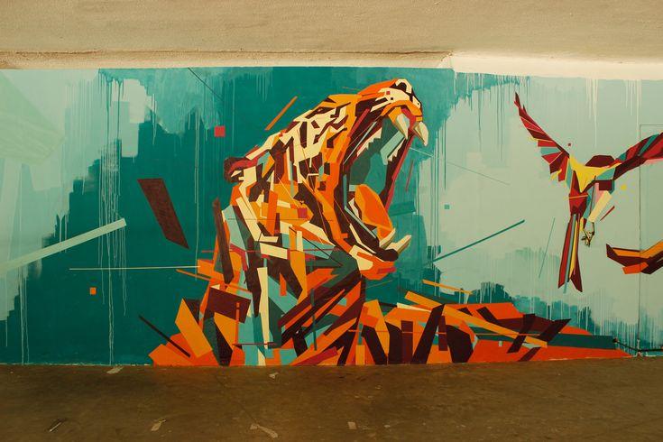 Rainbow Animals Roar Across Geometric Street Art Murals