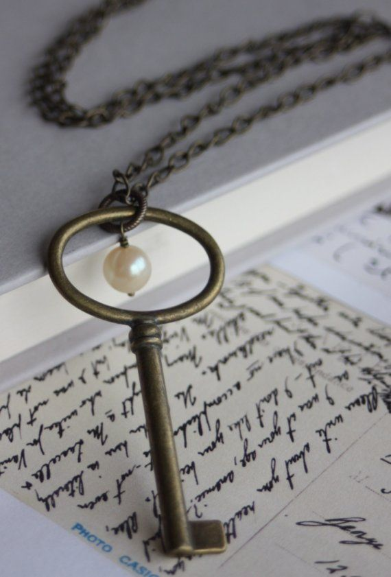 Hmm, have lots of old keys...Necklace made with a key and pearl.