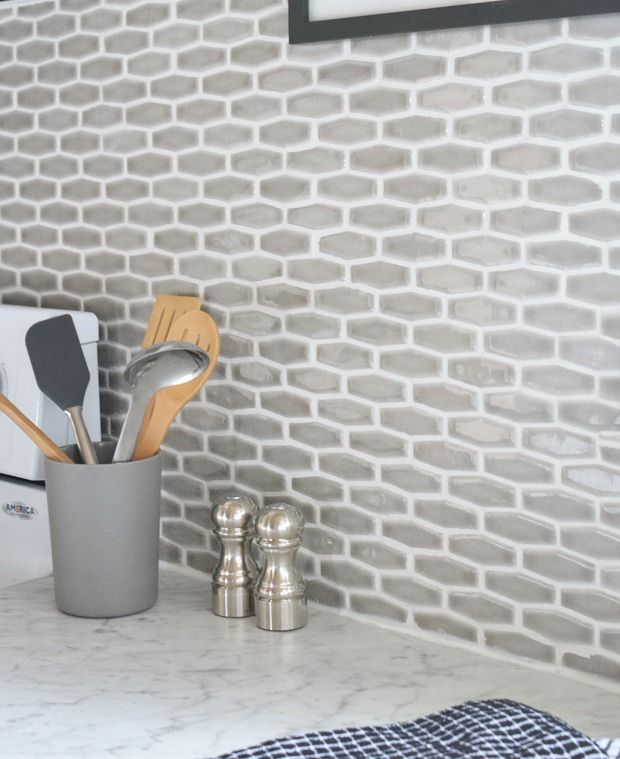 Budget Kitchen Makeover   Centsational Girl  Featuring contemporary edge Formica® Laminate Carrara Bianco countertop, white cabinets, and gray tile backsplash.