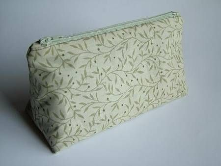 This is a top notch tutorial on making a cosmetic bag with wonderful directions for a beautiful zipper installation and how to draft your own pattern.  Five stars on this one.