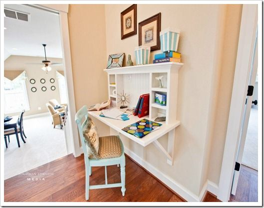 Small space homework station - the area at the top of the stairs is usually under-utilized. Why not add a built in homework station, customized for your child? They will love doing homework here!