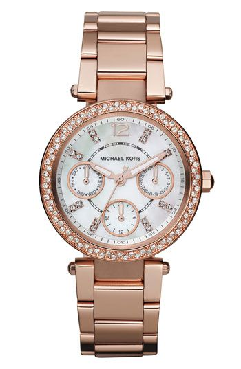 MK 'Parker' Multifunction Watch - $253.32 A high polish and bevy of sparkling crystals elevates a sophisticated round watch displaying date, date and 24-hour subdials. Deployant clasp closure. Approx. band length: 190mm. Approx. band width: 16mm. Approx. case diameter: 33mm. Water-resistant to 10 ATM (100 meters). Stainless steel/crystal/rose-gold ionic plating/mineral crystal/mother-of-pearl.