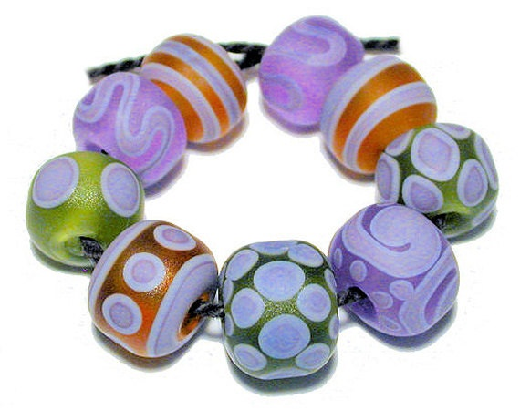 handmade artisan lampwork glass beads set flameworked by arcadia beads on etsy