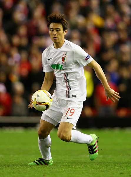 Koo Ja Cheol Photos - Koo Ja-Cheol of  FC Augsburg in action during the UEFA Europa League Round of 32: Second Leg match between Liverpool and FC Augsburg at Anfield on February 25, 2016 in Liverpool, United Kingdom. - Koo Ja Cheol Photos - 55 of 132