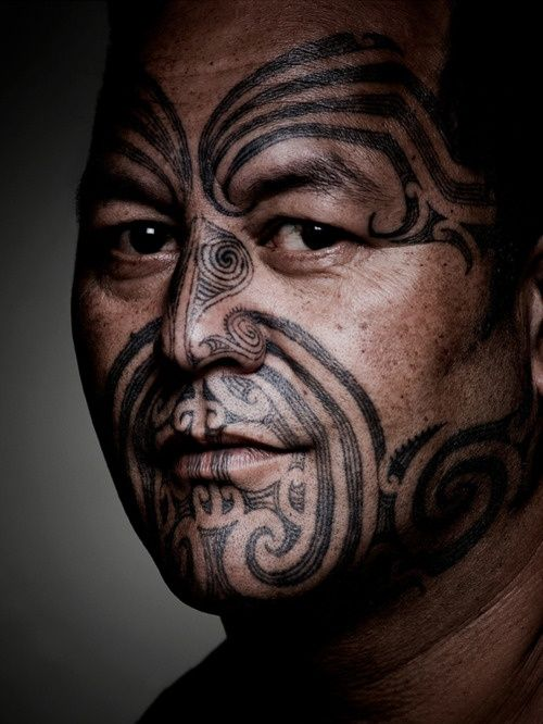 Handsome Maori man with traditional moko