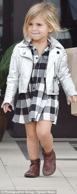 Cute: Penelope looked fab in a black and white plaid dress which she matched with an uber-...