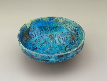 This type of bowl, decorated with painted fish and lotus flowers, was a ritual object in New Kingdom Egypt (ca. 1539–1075 BCE) and is often found in tombs.
