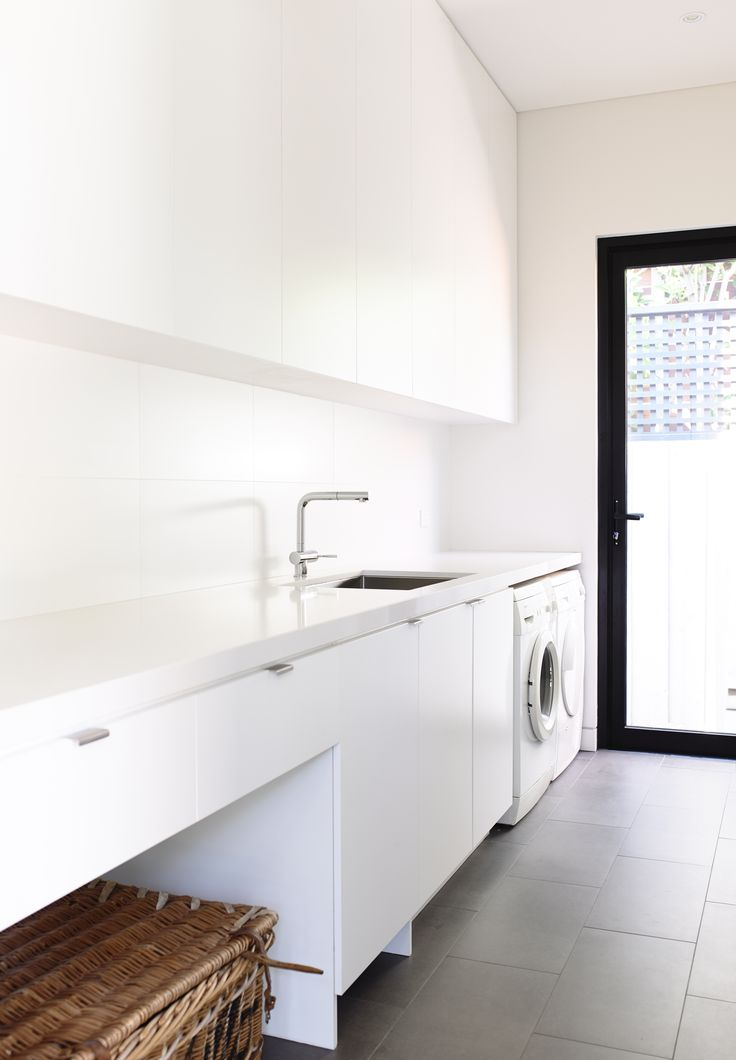Contemporary white Laundry or utility room.