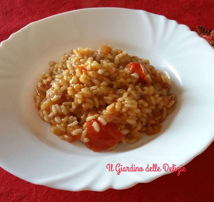Il risotto pomodoro e bottarga è un fine delicato gustoso primo piatto, insaporito quasi a fine cottura da bottarga di muggine