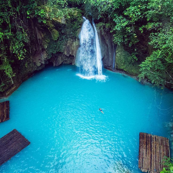 """Kawasan Falls at its finest I spy a very lucky @chelseakauai floating all by her lonesome This Philippines trip was filled to the brim with beautiful…"""