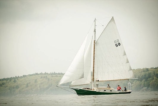 The Friendship Sloop Sarah Mead, sailing off the coast of the Spruce Point Inn in Boothbay Harbor