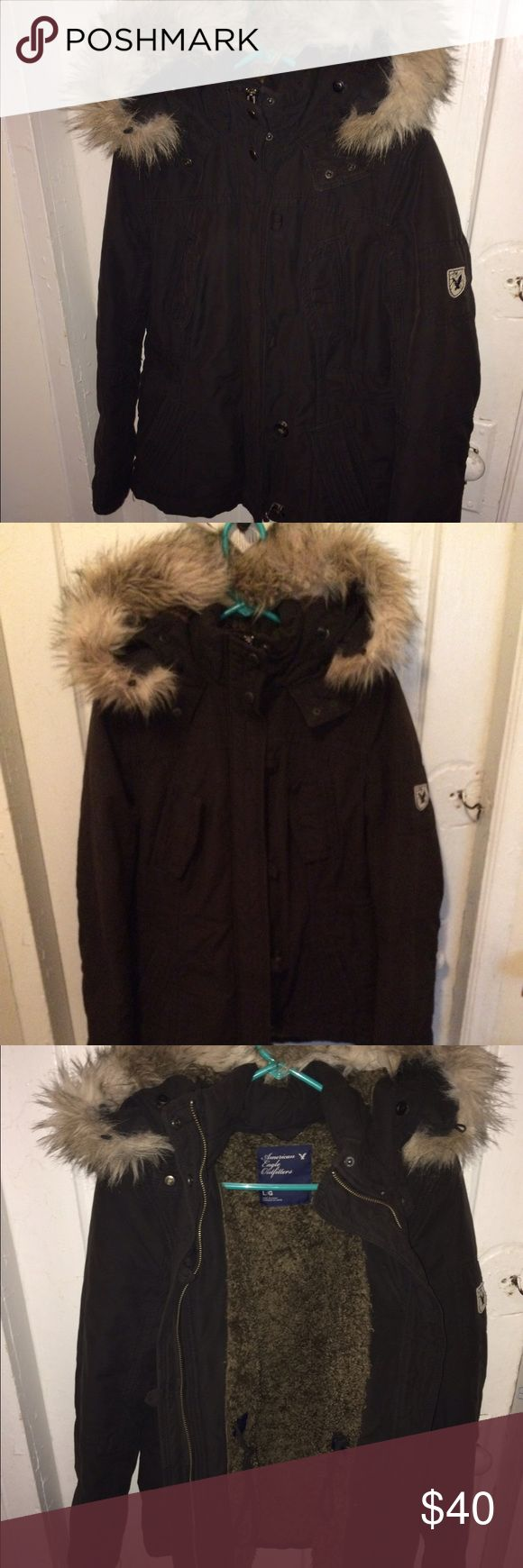Women's black American eagle parka Really warm coat. Black parka style with fur. This is a true women's large! Has a string inside to tighten the waist American Eagle Outfitters Jackets & Coats