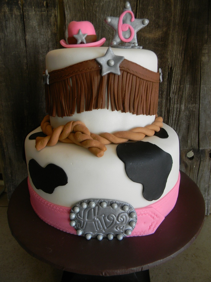 This will most likely be Avery's Cowgirl Cake! Her name in the buckle and Dora on the top!!!