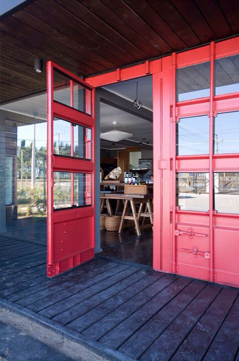 I like the modified shipping container doors here. Creative entry into shop