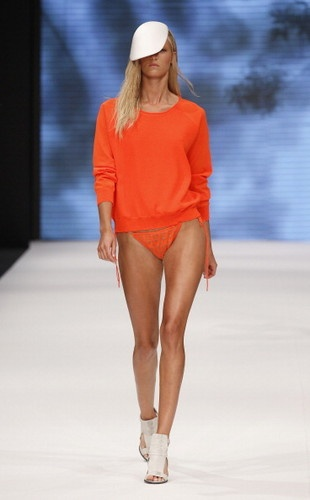 A model walks down the runway during the Dagmar S/S 2013 Fashion Show at the Mercedes-Benz Stockholm Fashion Week on August 28, 2012 in Stockholm, Sweden.