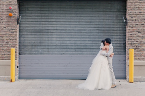 a pre-ceremony hug on the streets of NY  Photography by mademoisellefiona.comFirstlook