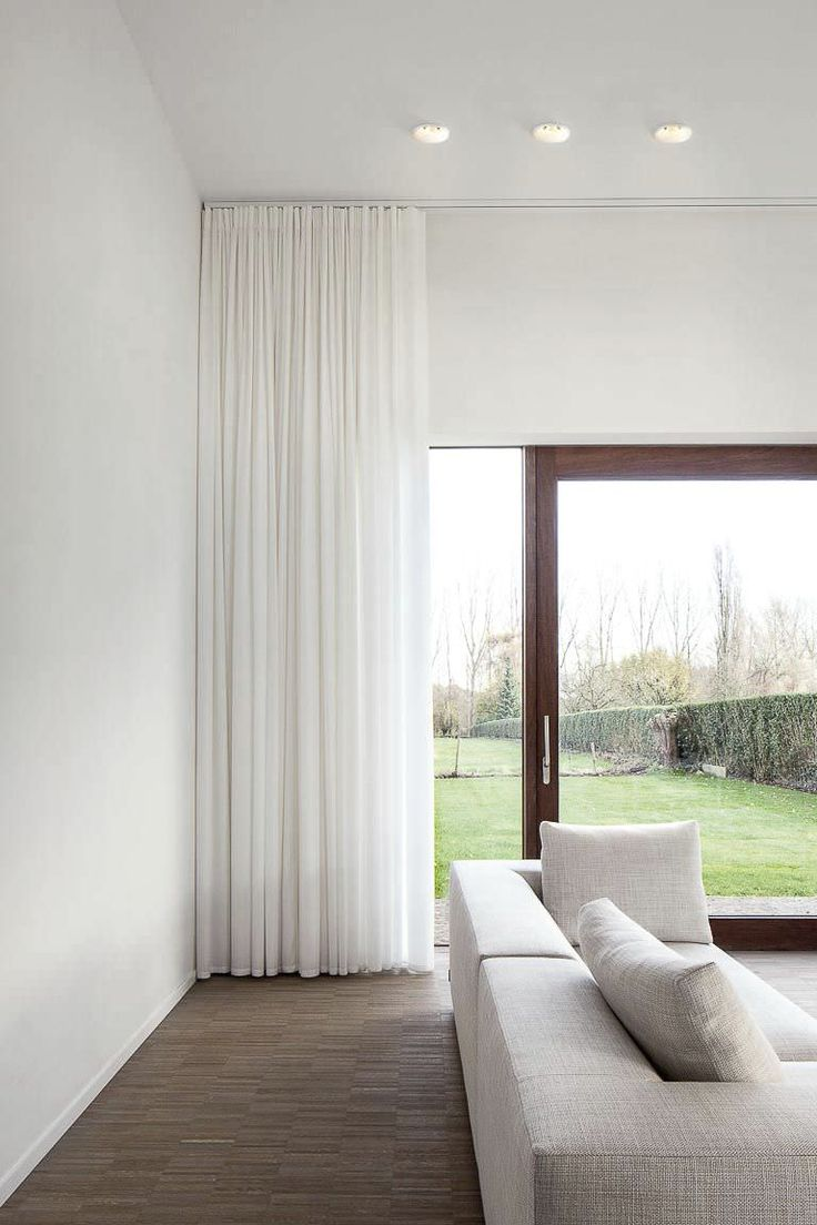 Sheer floor to ceiling curtains; great drama created by suspending these right from the ceiling