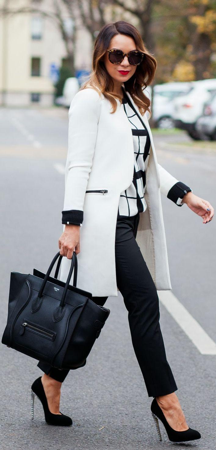Street fashion coat, heels, handbag and shades.