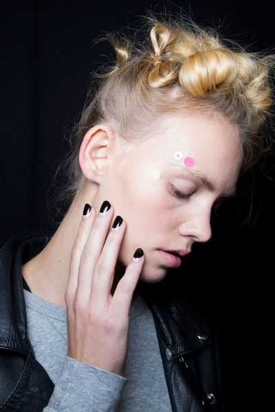 Best Nails at London, Milan and Paris Fashion Weeks Spring 2015 --  Antonio Marras, Milan, Spring 2015 --  For a rocker look from head to tip, the manicure at Antonio Marras was a dark black half moon.