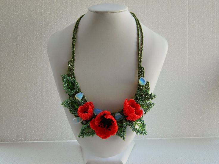 Poppy flowers  I thought that one poppy flower is not enough for a necklaces, so .....  Dimensions: Length of the necklace is approx. 46 cm. Materials: thread, single-string nylon thread, metal bolts, sand beads, semiprecious