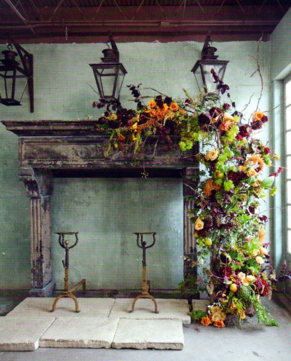Gorgeous Fall mantel via FRENCH COUNTRY COTTAGE. Florals and great andirons!