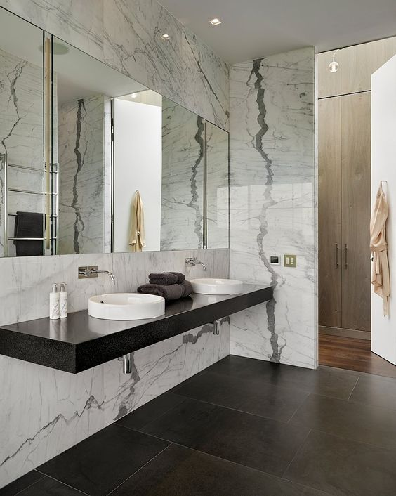 white marble with gray veining, black large scale tile floor, modern