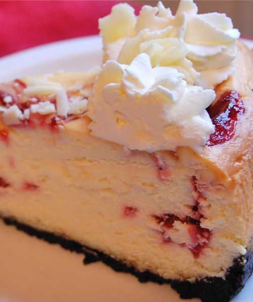 Recipe for Copycat Cheesecake Factory White Chocolate Raspberry Truffle Cheesecake - I like a rich cheesecake with nice height to it and I think a generous swirl of fresh whipped cream on top looks so nice.