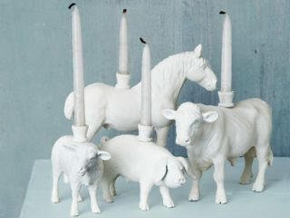 """<p>To show these plastic animals the light, we applied a technique featured on <a rel=""""nofollow"""" href=""""http://www.thesweetestoccasion.com/"""">thesweetestoccasion.com</a>. First, use a drill to make a small pilot hole in the flattest spot on the back of an animal <em>(from $3.49; <a rel=""""nofollow"""" href=""""http://www.anwo.com/"""">anwo.com</a></em>). Align the pilot hole beneath the hole in the bottom of a menorah candle cup <em>($9.95 for nine; <a rel=""""nofollow""""…"""