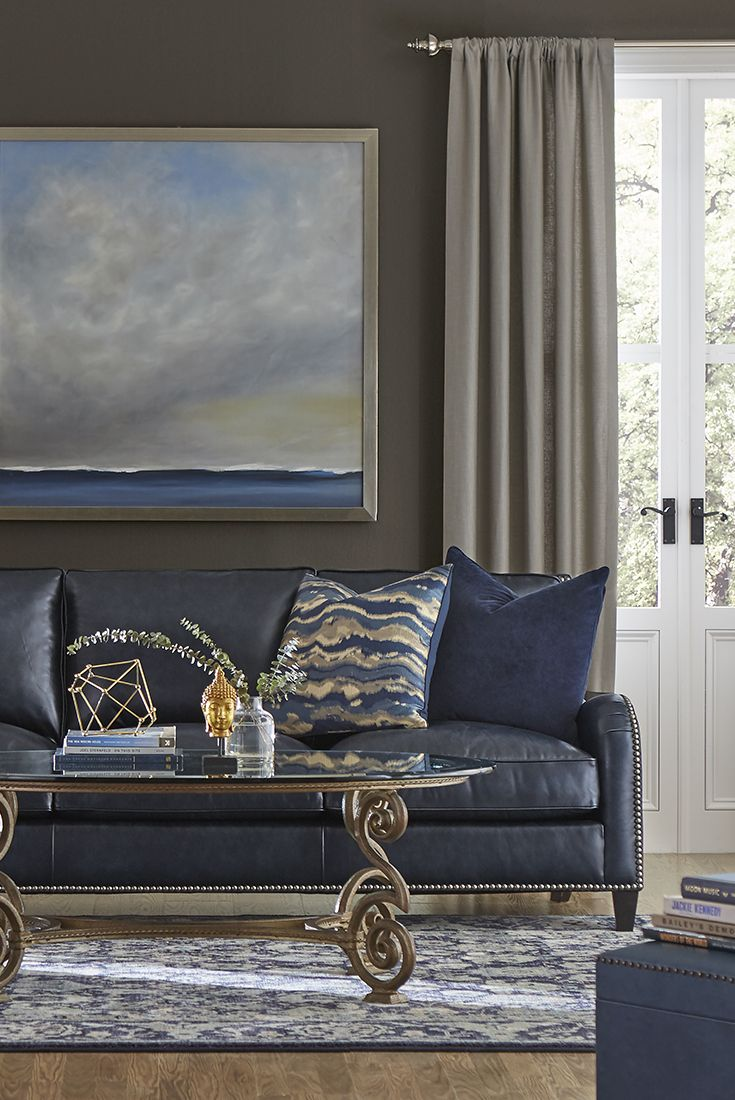 Spark a conversation around our Chicago sofa. This piece shows off a polished Lawson silhouette and daring navy blue leather upholstery. This semi-aniline, top-grain leather sofa also features a banded base with two tapered front and two shaped back feet. Havertys.