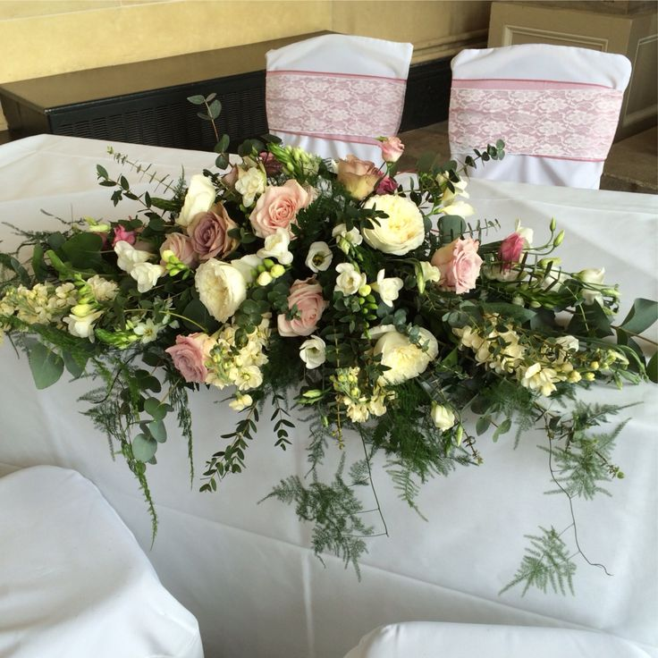 Traditional double end spray for registrar table display at Woburn sculpture gallery.  Antique style wedding flowers with amnesia roses, patience David Austin roses, stocks, freesia, faith roses, asparagus fern, eucalyptus.