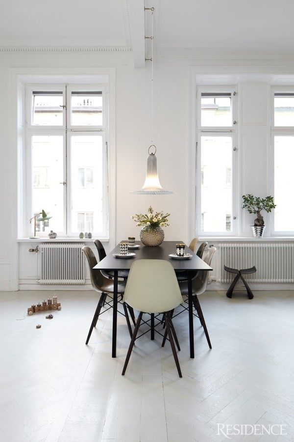varying shades of the classic Eames chair at the dining table - very unique