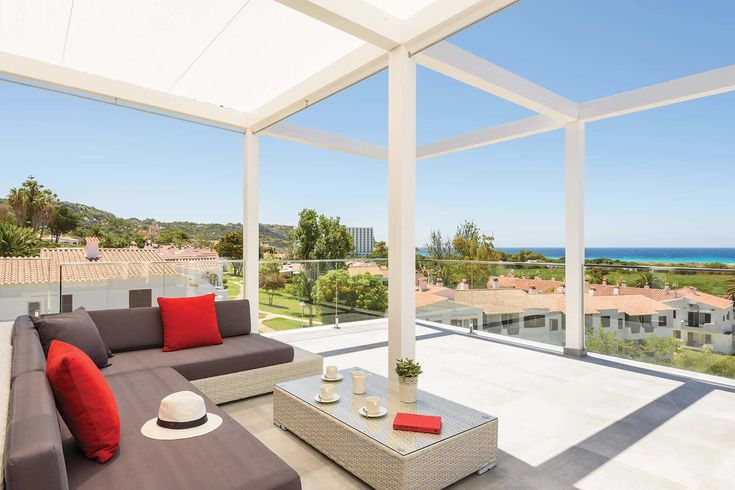 """Villa Dolce Vita in Menorca.  Our Contractor Mark says: """"My favourite spot, and one I hope to enjoy on a future family holiday, is the lounge terrace with its wonderful sea views over the pool. Son Bou has always been popular for the great beach and busy little resort centre, and now guests have one of our best villas to return to for relaxation."""""""