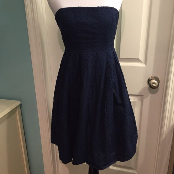 J. Crew navy Swiss dot strapless dress size 2p Fully lined. Navy fabric with textured Swiss dots. Skirt has pockets. Back zipper. Grippy strips and elastic bra-style band in bodice to prevent slipping. Size 2 petites but may not be too short on most women. J. Crew Dresses