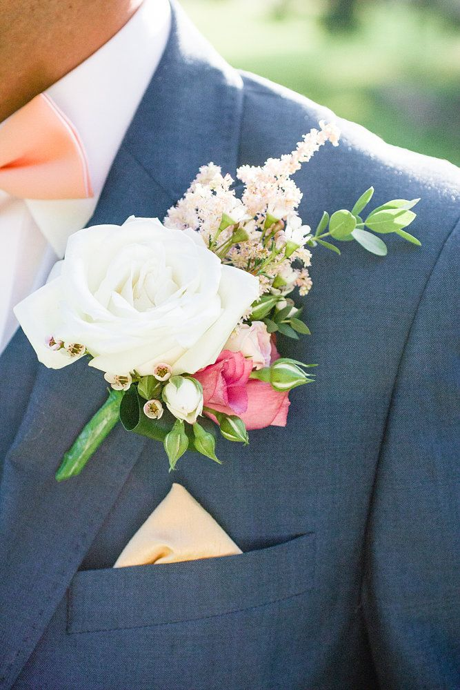Sweet blush pink boutonnière - love the grooms coral colour bow tie!!!