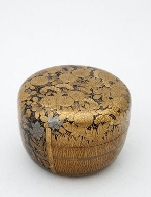 Japanese lacquered tea box or caddy (Usucha-ki or natsume) for holding the powdered tea used in tea ceremony, gold autumn flowers and bamboo fence motif on black, lacquered wood, Japan