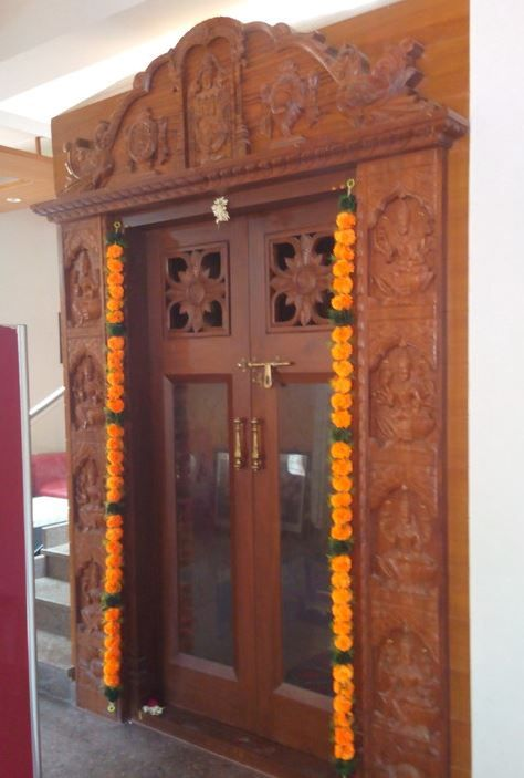Here are some beautiful pooja room door designs for you for Simple room door design