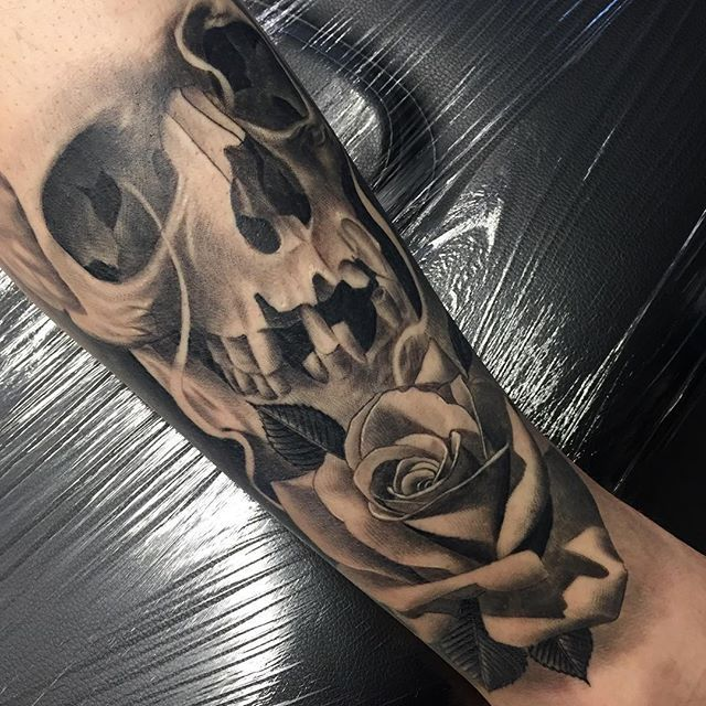 Skull and roses realistic black and grey sleeve done by