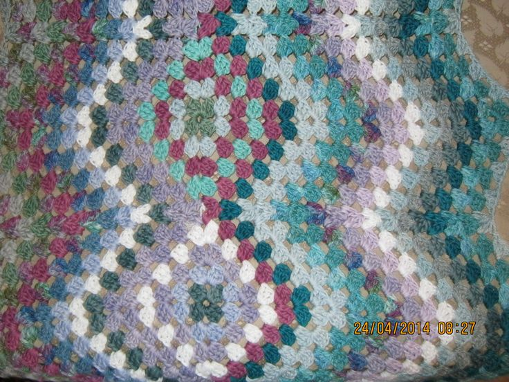 A table runner in a combination of Vinnis Nikkim cottons as well as One O a Kind Yarns' organic cottons – my own variation of a granny ripple pattern.
