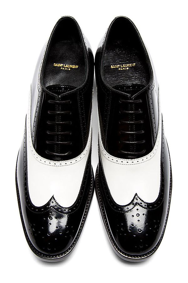 Black & White Leather University Richelieu Spectator Shoes by Saint Laurent. Low-top buffed leather spectator shoes in black and white. Wingtip paneling and broguing accents throughout. Round toe. Black oxford-style lace-up closure. Tonal sole and stitching. http://www.zocko.com/z/JJXBx